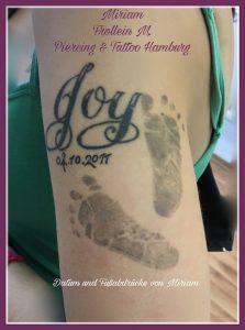 Babyfußstempel-Tattoo