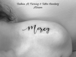 """Mercy"" Lettering Tattoo"